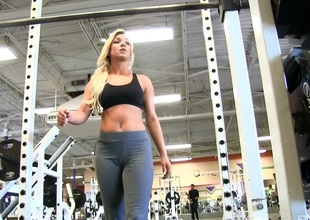 Foxy blonde burns and tremble guys working out in the gym