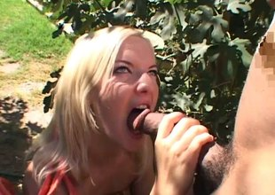 Zestful blonde with fake tits getting drilled anal in an interracial sex