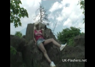 Teen blonde flashers outdoor striptease of young amateur exhibitionist Emma showing tits and exposing herself for voyeur