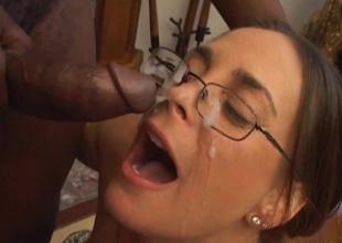 Adorable pornstar in glasses giving big cock wild blowjob in interracial shoot