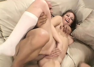 Alluring college angels take turns blowing and fucking a stiff cock on the couch