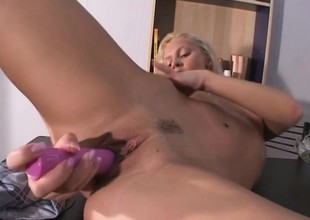 Kinky Jenny enjoys a relaxing moment with her long pink dildo