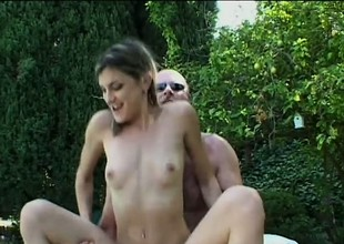 Sultry honey with tiny tits is swallowing tasty dooflicker outdoors