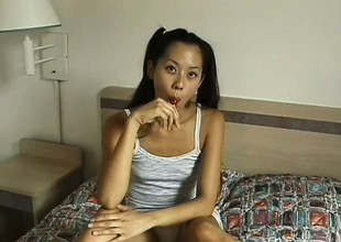 Skinny Asian whore gets her hairy cunt eaten out in a hotel room