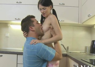 Tiny brunette hair teen with pale skin fucked in her kitchen