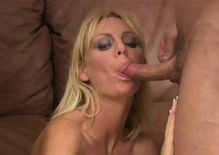 Cum-drinking young blonde Amber works two cocks at the same time