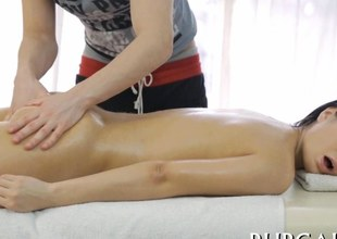 Oiled up raven amateur licked and fucked by her young masseur