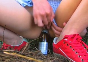 Naughty schoolgirl Beata came in the countryside to visit her grandparents during summer vacation. Beata forgot her toy at home and needs to use improvised bottle-dildo.