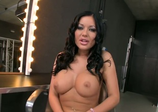 Angelica Heart with gigantic hooters finds herself horny enough and takes sex toy in her honeypot with wild passion
