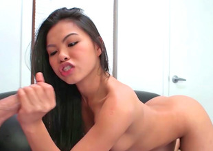 Great looking Oriental girl is in the mood to engulf