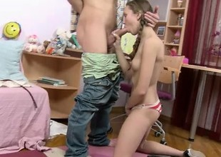 Beautiful teen with pigtails gets her juicy holes drilled deep and coarse from behind
