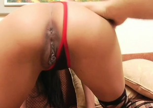 Tattooed Oriental babe gets a big bone probing and pumping her wet hole
