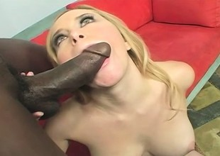 Busty blonde takes every inch of a huge black dick in her pussy and fully enjoys it