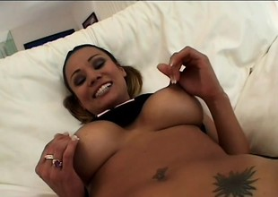 Big-jugged cutie spreads her darksome pussy lips and gets wild slamming