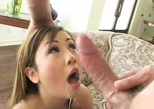 Smooth skinned Asian babe gets her pretty pink slit slammed hard