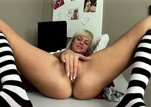 Naughty blonde secretary Cathy pleases her fiery snatch in the office