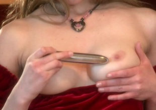 Busty,blonde uses a vibrator to tease her juicy pussy in a close up solo clip