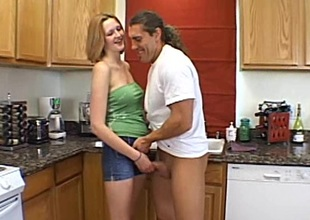 Petite amateur babe with natural boobs milking a cock in the kitchen