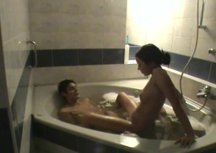 Teen couple filmed as they fool around in the bathtub