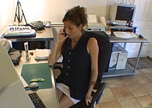 Salacious cougar in sexy lingerie swallows cum after milking a cock in the office