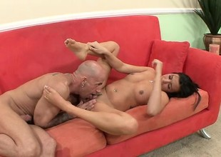 Skinny brunette with perky tits uses her sensual feet to please