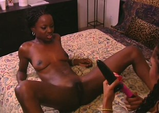 Ebony babes Mocha and Crystal lap up each other's pussy fluids