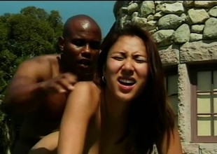 Lusty Asian tart is having tender foreplay and gets dicked outdoors