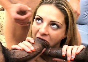Luscious blonde Nikki has a group of black guys stretching her holes