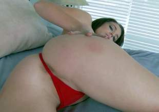 Slender tempting and naughty young brunette Kiera Winters with natural boobies in red undies only teases with taut tight firm ass and enjoys polishing sweet pink honey pot in bedroom