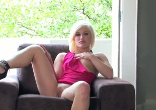 Ash Hollywood gets rid of her panties, keeping her pink dress and her high heels on for this solo session. And the session is superhot with Ash Hollywood going berserk on her pulsating clit.