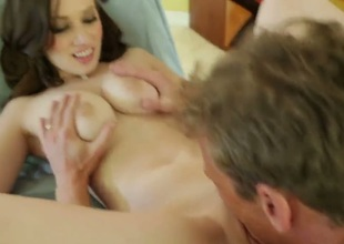 Natalie Moore is a total stunner of a chick and today she is having naughty fun with Ryan Mclane and his enormous cock. She deepthroats the fucker and impales her creamy slit on it.