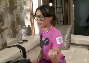 Naughty and sexy dark haired babe Tiffany Doll in short pink provocative skirt and tight t-shirt with nerdy glasses sucks really hard and meaty cannon in the bathroom on the floor