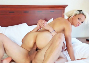 21 year old blonde is on the bed with a guy