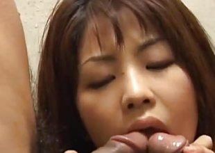 Asian babe sucking double dick