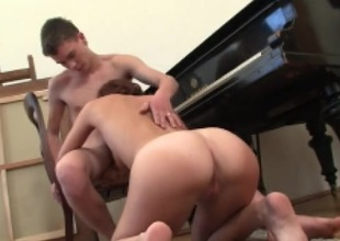 Teen bent over the piano and fucked doggystyle
