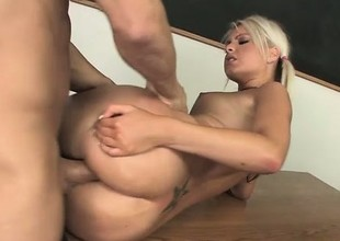 Blonde cutie with worthy tits has her teacher drilling her tight peach