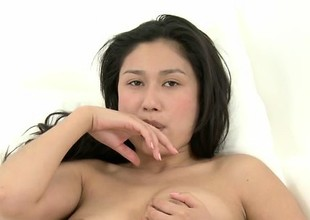 Alluring Asian beauty Ming caresses her perfect shaven pussy