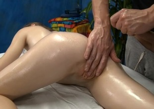 Rubbing oil all over beauty's body makes her very horny