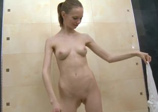 Skinny Gloria with beautiful plump boobs dabbles in the bath with her tiny, elegant pussy! She looks so innocent, but this babe can invite your dick in her asshole with pleasure!