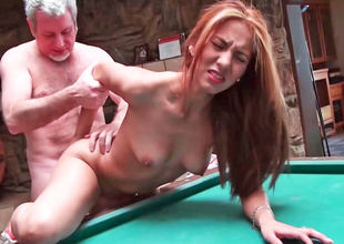 Brunette hair is having some hot sex on the pool table here