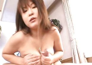Japanese brunette drools over this hard dick